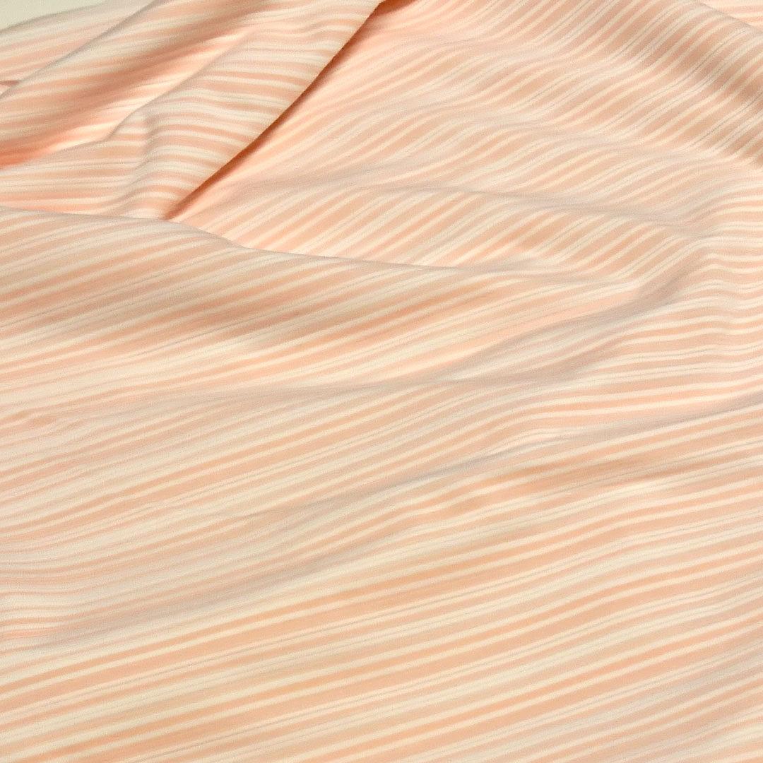 Baumwolljersey Apricot-Weiß gestreift